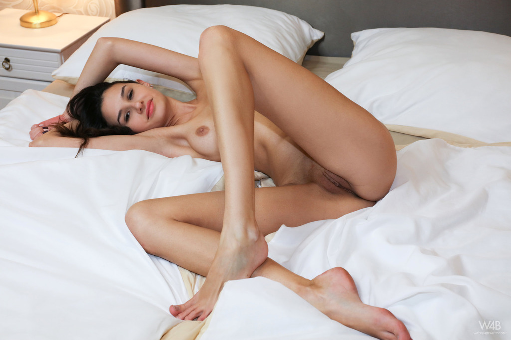 Topless Skinny Girl Laying On The Bed